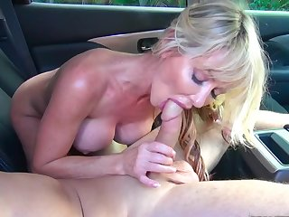 Milf loves shagging on be passed on back seat with younger guy